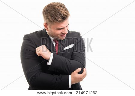 Business Man Standing Holding Elbow Like Hurting