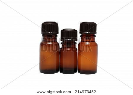 three bottles of aromatherapy oils isolated close-up
