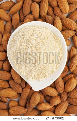 Bowl of almond flour and almonds from above.