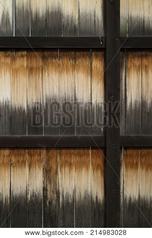 Weathered old wooden structure in an iron frame full frame