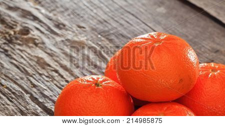 Tangerines on a wooden table, copy space