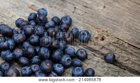 Stack of blueberries, on a wooden table, copy space