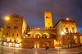 Palazzo del Podesta, Piazza Maggiore & Neptune fountain at night in the centre of Bologna.