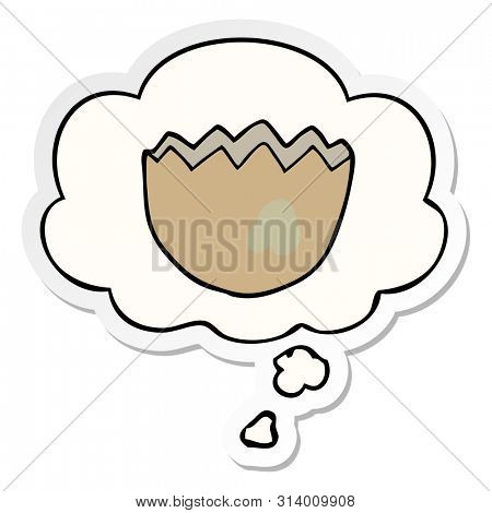 cartoon cracked eggshell with thought bubble as a printed sticker poster