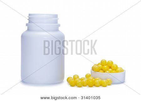 Yellow Pills And A Plastic Bottle