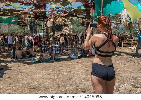 Riomalo De Abajo, Extremadura, Spain - July 13, 2018: A Young Redhead Woman In Bathing Clothes Takes