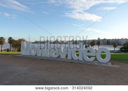 Montevideo/uruguay-6/1/19: Montevideo Sign And Skyline At The La Rambla On A Beautiful Sunny Winter