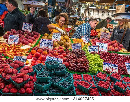 Seattle, Washington - May 13, 2017: Pike Place Market Is A Public Market Overlooking The Elliott Bay