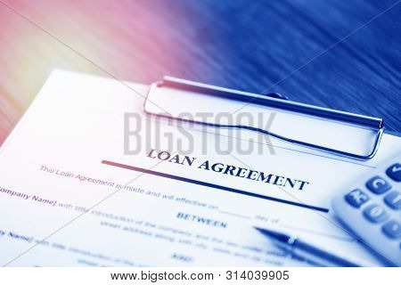 Loan Application Form With Pen And Calculator On Paper Financial Help / Financial Loan Negotiation F