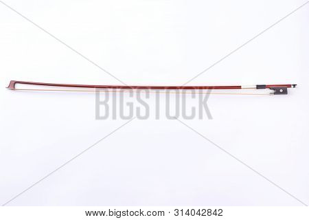Fiddle Stick Isolated On White Background. Studio Shot Of Violin Bow. Vintage Classical Violin Fiddl