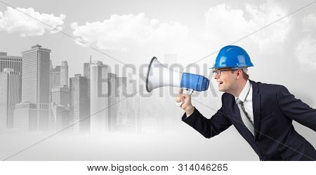Young supervisor architect yelling to far big city panorama poster