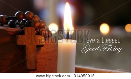 Good Friday Concept. Have A Blessed Good Friday. With Candle Light And Wooden Rosary And Crucifix Of