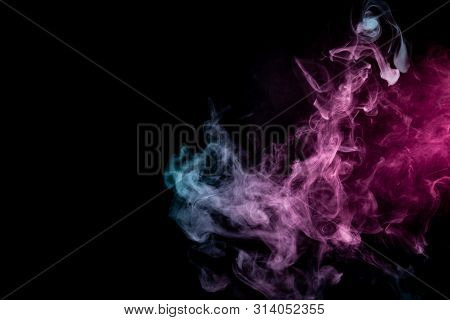 Colored background with winding clouds of smoke from patterns of different forms of pink, green and blue colors with tongues of flame on a black isolated background. Print for t-shirt. poster