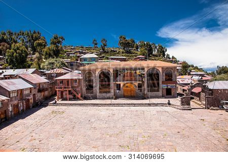 Taquile island , Titicaca lake, Peru- Jan 5, 2019: Houses on a central square in a village on Taquile island in Titicaca lake, Peru. South America.