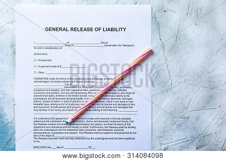 Filling General Release Of Liability Form Paper On Bright Background