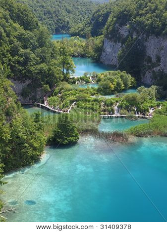 Plitvice, Croatia - July 7: Tourist Enjoy Sightseeing The Lakes And Wonderful Landscapes At The Plit