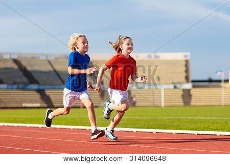 Child Running In Stadium. Kids Run. Healthy Sport.