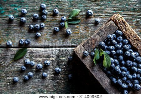 Freshly Picked Blueberries Are In A Wooden Box A