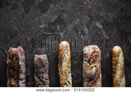 Baguette Mix On A Black Background. French Pastries, Homemade. A