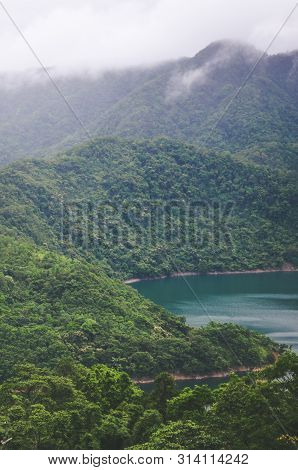 Foggy Landscape By Beautiful Thousand Island Lake In Taiwan, China, Asia. Lake Surrounded By Deep Tr