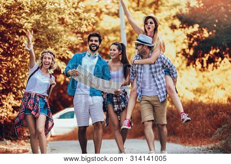 Group Of Smiling Friends Walking With Backpacks In Woods - Adventure, Travel, Tourism, Hike And Peop