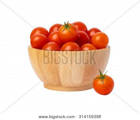 Group Red Tomatoes In A Wooden Bowl Isolated On The White Background. Cherry Tomato Is A Small That