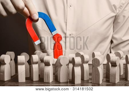 Businessman Pulls Out A Red Figure Of A Man From The Crowd With The Help Of A Magnet. Toxic, Non-com