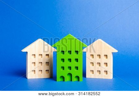 Green Figure Of A Residential Building Stands Out Among The Rest Of The Houses. Search For The Best