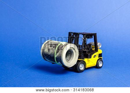 Forklift Truck Carries A Bundle Of Dollars. Export Of Capital, Offshore Economic Zones. Attracting D
