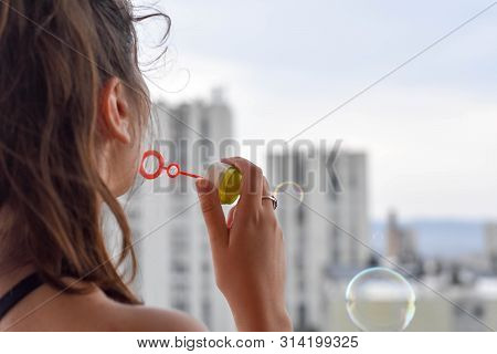 Happy Beautiful Woman Blowing Soap Bubbles Outdoor/ Conceptual Image Of Childhood - Image