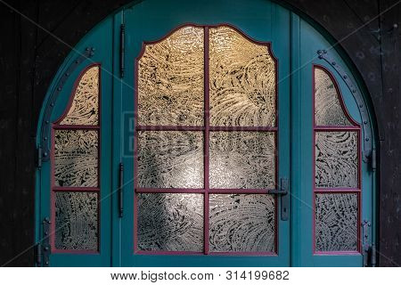 Vintage Blue Door Decorated With Round Etched Windowpanes