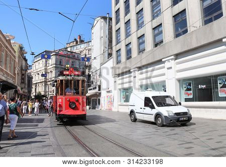 ISTANBUL, TURKEY - JUNE 7, 2019: Retro red tram Taksim-Tunel on famous Istiklal street
