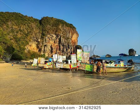 Thailand, Krabi Aonang Beach- February 19, 2019: Floating Food Market. Boats With Fast Food Ashore