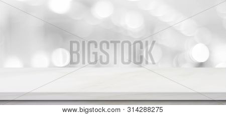 Empty White Table Top, Counter, Desk Background Over Blur Perspective Bokeh Light Background, White