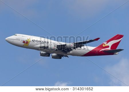 Sydney, Australia - October 7, 2013: Qantas Boeing 747 Jumbo Jet Commercial Airliner Taking Off From
