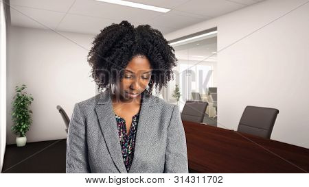 Black African American Businesswoman In An Office Looking Sad Or Depressed.  She Is An Owner Or An E