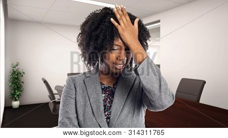 Black African American Businesswoman In An Office Making A Mistake.  She Is An Owner Or An Executive