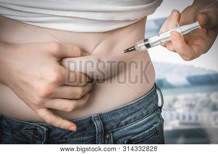 Diabetic Woman With Syringe Inject Insulin To Her Belly - Diabetes Concept