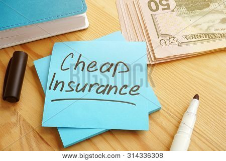 Cheap Insurance Concept. Money And Notepad With Pen.