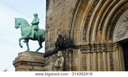View of Monument of the Reichskanzler Otto von Bismarck on horseback near the Cathedral of St. Peter, Bremen, Germany poster
