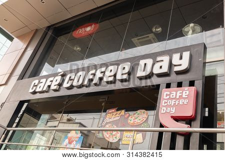 Bengaluru, India June 27, 2019 : Front View Bill Board Of Cafe Coffee Day Shop Building At Bengaluru
