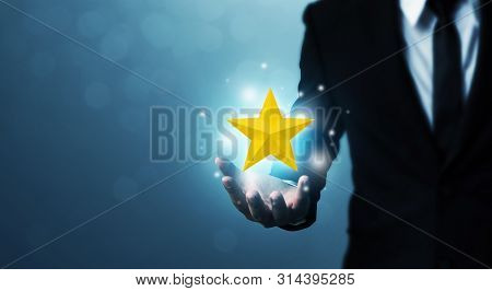 Businessman Hands Hold A Five-star Gold Shape. The Best Excellent Business Services Rating Customer