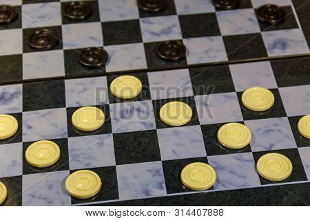 Checkerboard with checkers. Draughts on playing field. Game concept. Board game poster