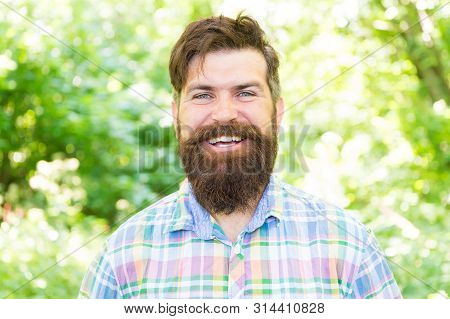 Making Happiness Possible. Happy Hipster With Smiling Face On Summer Landscape. Bearded Man With Lon