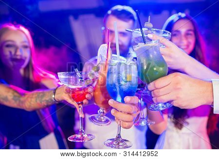 Friends With Cocktails Drinks At A Party In The Club