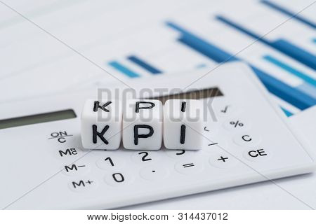 Key Performance Indicator, Kpi Measurement To Evaluate Business Success, White Cube Block With Alpha