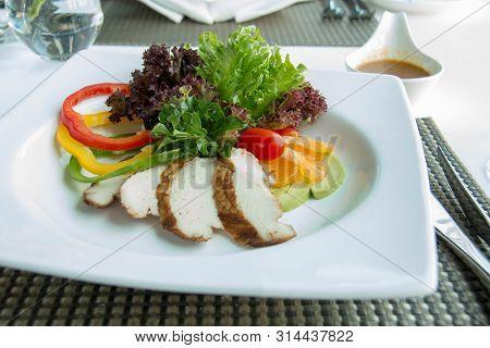 A Delicious Chicken Slice Salad In White Plate