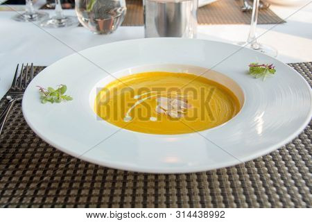 A Delicious Pumpkin Soup In White Bowl