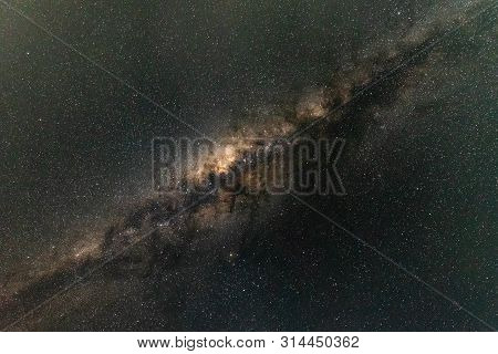 Milky Way Galaxy In Clear Night Sky.the Milky Way Is Is A Barred Spiral Galaxy With Large Group Of S