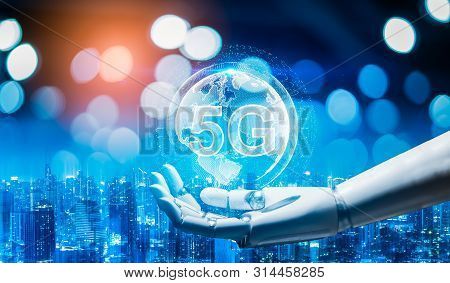 Robot Android Hand Holding Icon 5g.5g Network Digital Hologram And Internet Of Things On City Backgr